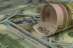 Dollars en Roebels stock foto's