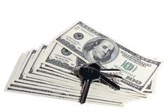 Dollars en sleutels Stock Foto