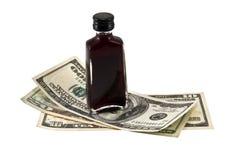 Dollars en volledige fles. Stock Afbeelding