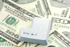 Dollars and a enter key Stock Image