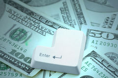 Dollars and a enter key. Concept online shopping Royalty Free Stock Image