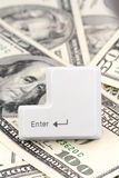 Dollars and a enter key Stock Photos