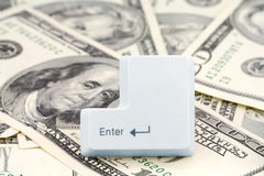 Dollars and a enter key. Concept online shopping Royalty Free Stock Photography