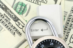 Dollars and a enter key. Concept online shopping safety Stock Photo