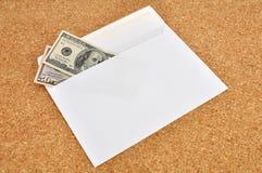 Dollars in an envelope Royalty Free Stock Photo