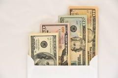 Dollars in Envelope. American Dollars in White Envelope on a White Royalty Free Stock Photos