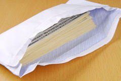 Dollars in an envelope Royalty Free Stock Photo
