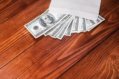 Dollars in an envelope Royalty Free Stock Image
