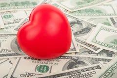 Dollars et coeur rouge Photo libre de droits