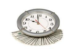 Dollars et horloge Photos stock
