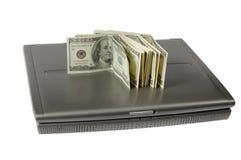Dollars et l'ordinateur portatif Photo libre de droits