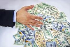 Dollars et mains américains Photographie stock libre de droits