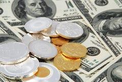 Dollars et pièces de monnaie Photographie stock libre de droits