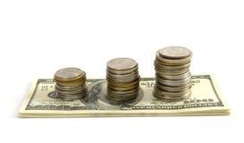Dollars et pièces de monnaie i Image libre de droits