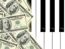 Dollars et piano Photographie stock