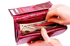 Dollars et pochette rouge photo stock