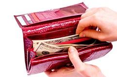 Dollars et pochette rouge Photo stock