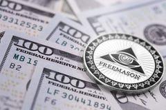 Dollars et symbole de franc-maçonnerie photos stock