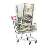 Dollars and euro cash in shopping trolley Royalty Free Stock Photography