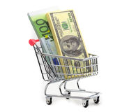 Dollars and euro cash in shopping trolley Stock Photos