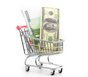 Dollars and euro cash in shopping trolley Royalty Free Stock Images