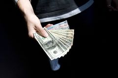 Dollars and euro in a hand Royalty Free Stock Photos