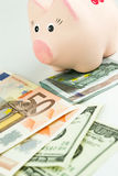 Dollars, Euro and moneybox. Close up Royalty Free Stock Image