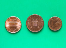 Dollars, Euro and Pounds - 1 Cent, 1 Penny. Dollars, Euro and Pounds currency of United States, European Union and United Kingdom - One Cent and One Penny Royalty Free Stock Photos