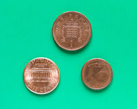 Dollars, Euro and Pounds - 1 Cent, 1 Penny. Dollars, Euro and Pounds currency of United States, European Union and United Kingdom - One Cent and One Penny Royalty Free Stock Photography