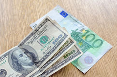 Dollars on the euro. On the table Royalty Free Stock Photography