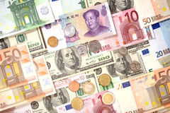 Dollars, Euro and Yuan banknotes and coins background Stock Image