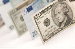 Dollars and Euros. Isolated cash banknotes of dollars and euros Stock Photo