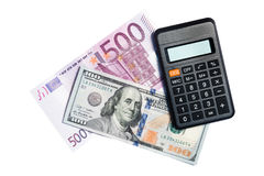 100 dollars, euros 500 et calculatrices Images stock