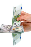 Dollars and Euros in hand Stock Images
