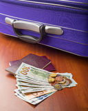 Dollars, Euros and Passports Stock Images