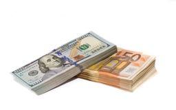 Dollars and Euros. Stacks of dollar and euro bills Stock Image