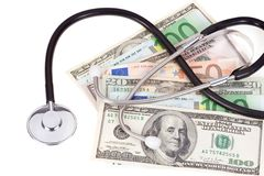 Dollars and euros with stethoscope Stock Photography