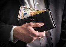 Dollars and euros in wallet. Royalty Free Stock Image