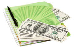 Dollars and exercise book. Heap of dollars and exercise book isolated on a white background Stock Photography