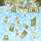 Dollars fall. Isolated on cloudy sky background Royalty Free Stock Images