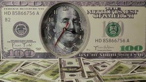 The dollars are falling on the background of hundred dollar bills. Us dollars stock footage
