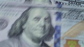 100 dollars falling down macro stock footage