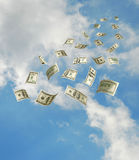 Dollars falling from sky Stock Photo