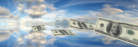 Dollars falling sky Royalty Free Stock Photos