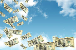 Dollars falling from the sky Royalty Free Stock Images
