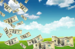 Dollars falling from the sky (Select Focus ) Royalty Free Stock Image