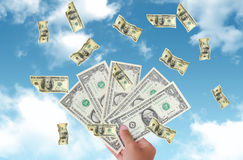 Dollars falling from the sky (Select Focus ) Stock Images