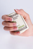 Dollars in female hand. Royalty Free Stock Photography