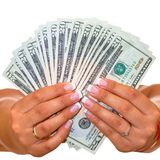 Dollars in female hands isolated stock images