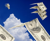 Dollars fly away Stock Photography